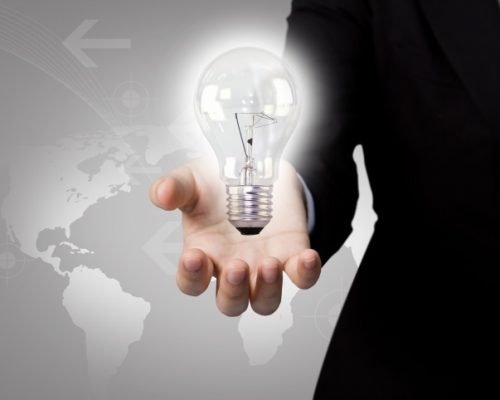 businessman-with-light-bulb-map-background_1232-161